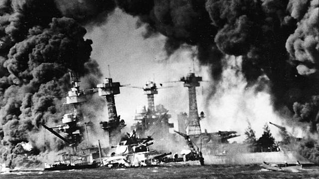 At 7:55 AM on a Sunday, hundreds of Japanese warplanes, launched from aircraft carriers far out at sea, attack the American Pacific fleet anchored at Pearl Harbor, Hawaii, based on a plan by Isoroku Yamamoto.
