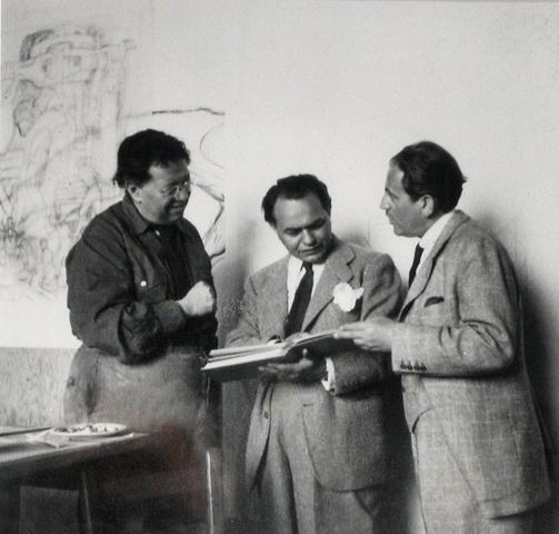 Rivera, Edward G. Robinson, and art dealer Sam Salz visit in Rivera's studio behind the mural in June 1940.