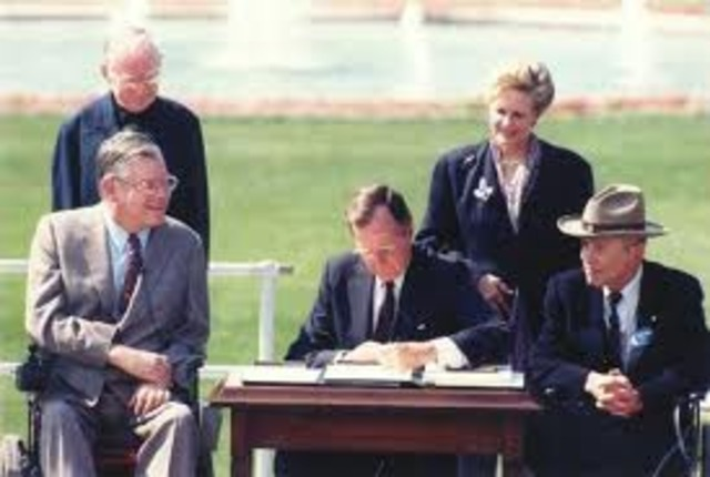 President Bush signs Americans With Disabilities Act into Law