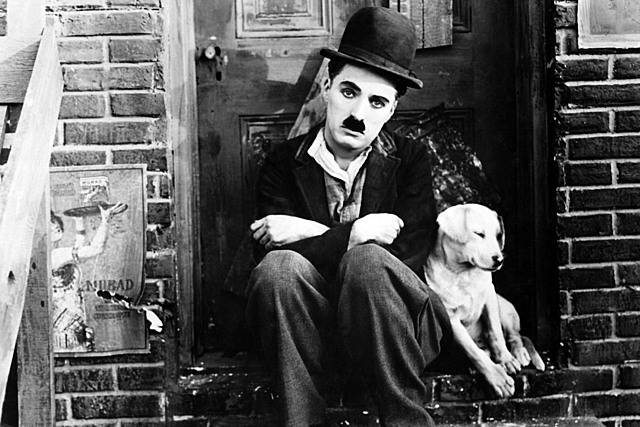 Charlie Chaplin signs with First National