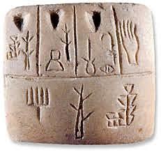 Escritura sumeria cuneiforme.