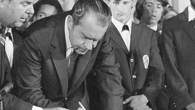 Richard Nixon signing the extension of the voting rights act