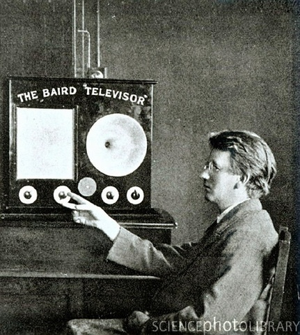 """Scotsman John Logie Baird invents mechanical television which he calls a """"Televisor"""",           a postcard-sized black and pink image"""