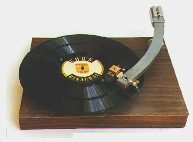 """An experimental """"binaural"""" phonograph system is created by Bell laboratories.            The two channels of sound were on separate grooves of a 78rpm vinyl record, requiring"""