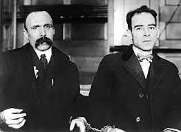 Sacco and Vanzetti arrested for armed robbery and murder