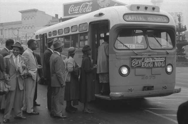 MLK  is among the first passengers to ride the buses in an integrated fashion.