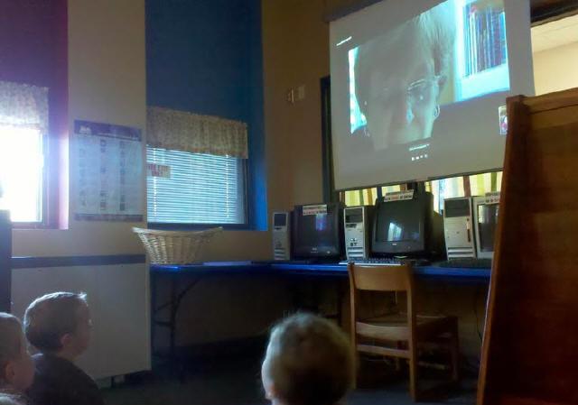 Cybrary Man and wife Read to 2nd graders Van Meter, Iowa