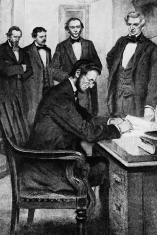 Lincoln signs the Emancipation Proclamation.