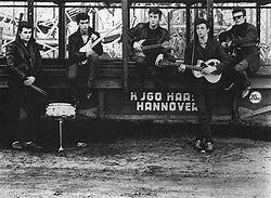 Lennon's art-school friend Stuart Sutcliffe joined and played bass.
