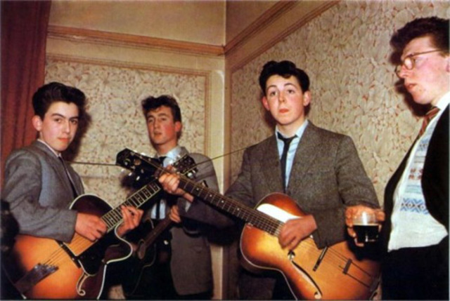 George Harrison and Paul McCartney join the Beatles