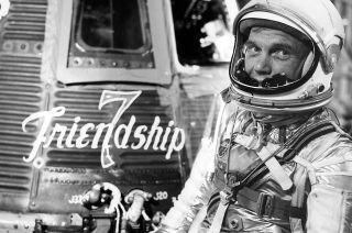 First American to do an orbital flight around Earth