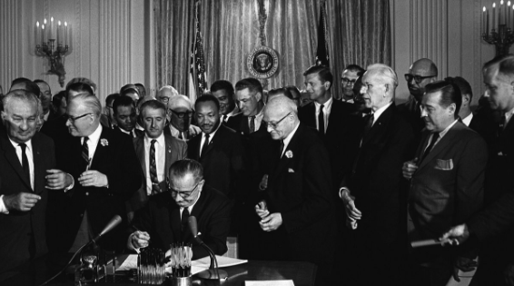 Civil Rights Act of 1964 signed by President Johnson