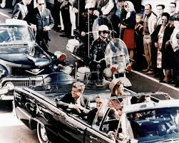 John F. Kennedy is assassinated in Dallas, TX