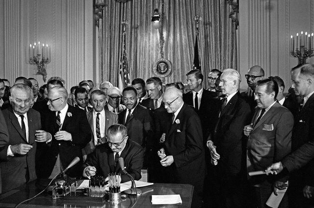 The civil rights Act of 1964 signed by president johnson