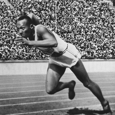 Jesse Owens wins first gold medal