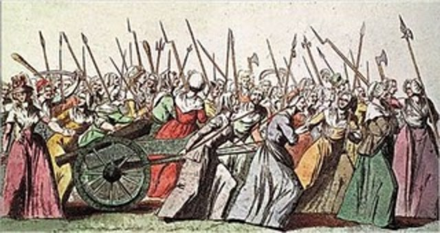 Women lead delegation to King in Versaille demanding bread. After scuffles, they are fobbed off by the King.