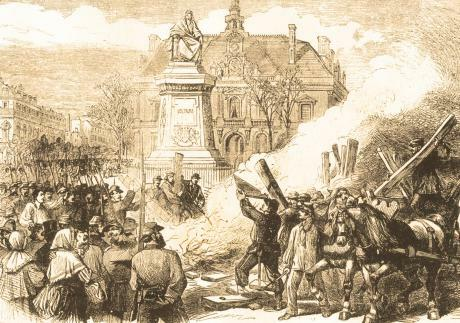 Members of the 137th battalion of the Commune's National Guard publicly burn the guillotine in the Place Voltaire (now Place Léon Blum) in the 11th arrondissement of Paris