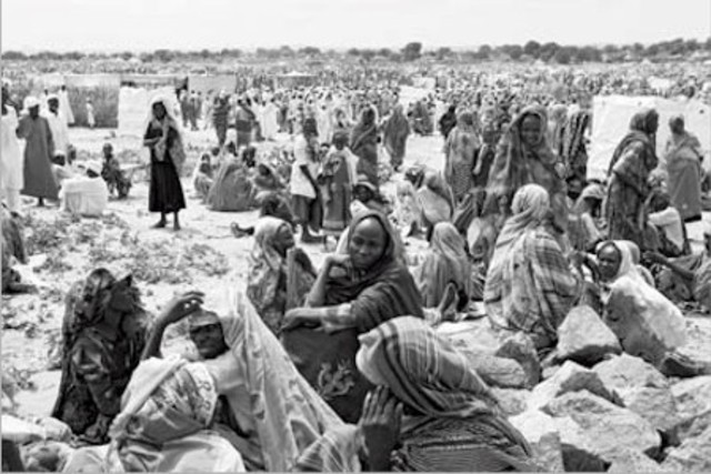 The Sudanese army moves to quell rebel uprising in webstern region of Darfur; hundreds of thousands of refugees flee to neighbouring Chad