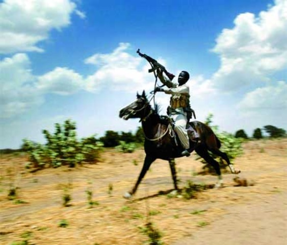 Pro-government Arab Janjaweed militias begin to carry out systematic killings of non-Arab villagers in Darfur