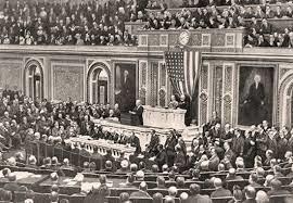 Woodrow Wilson delivers his Fourteen Points speech.