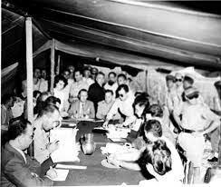 Representatives of warring nations sign armistice.