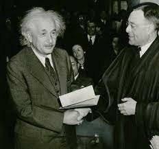 Albert Einstein receives the Nobel Prize in physics.