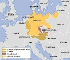 Germany takes Rhineland (violates treaty of versailles)