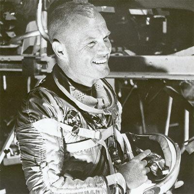 First man to orbit Earth by USA (John Glenn)