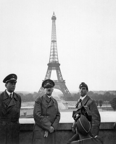 France surrenders to the Axis Powers (Vichy France)