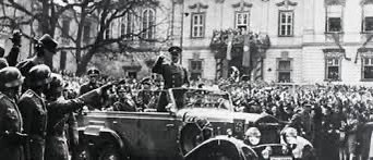 Germany violates the Treaty of Versailles by reoccupying the Rhineland