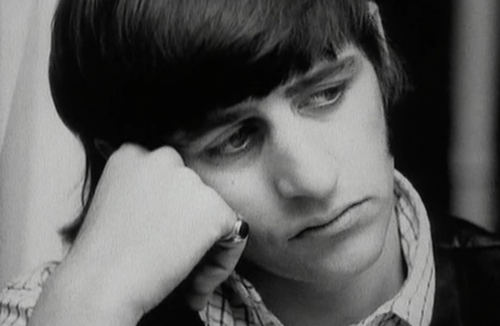 The Beatles break up as a group