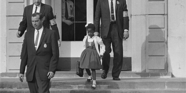 Ruby Bridges desegregate elementary school in New Orleans