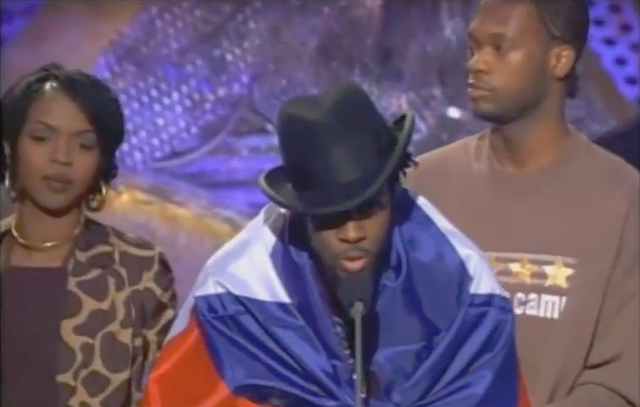 The Fugees' album, The Score, wins two Grammys and debuts at number one