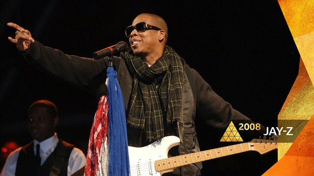 Jay-Z becomes the first rapper to headline Glastonbury, the largest greenfield music and performing arts festival in the world.