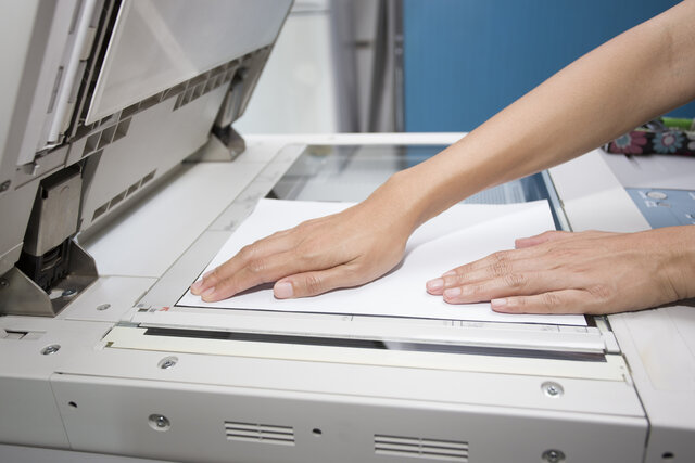 Copier with moving light bar.
