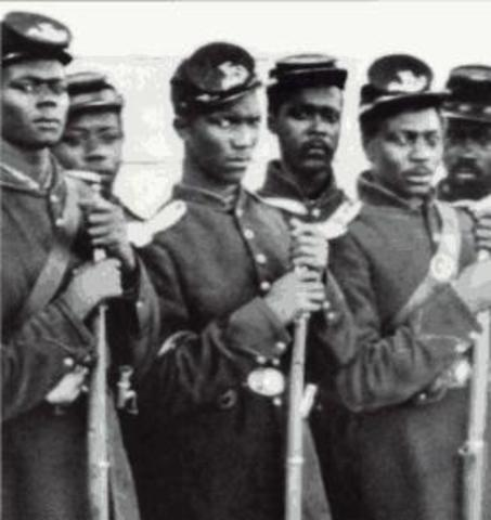 Congress repeals all Fugitive Slave laws and Black Union troops granted equal pay