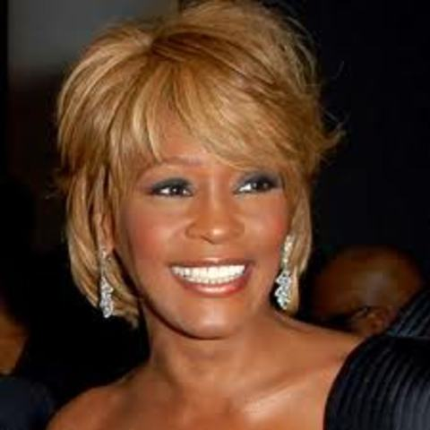 Whitney Houston releases her first self-titled album