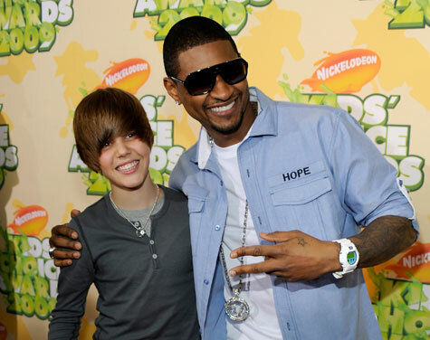 Bieber signs with Scooter and Usher