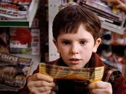 Charlie gets the golden ticket, sweet shop