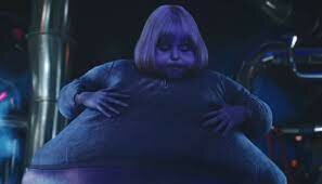 Violet gets turned into a blueberry,  inside the chocolate factory