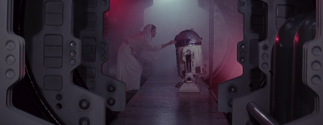 Princess Leia puts some kind of chip into R2-D2