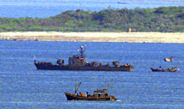 North Korean submarine torpedoes a South Korean gunboat