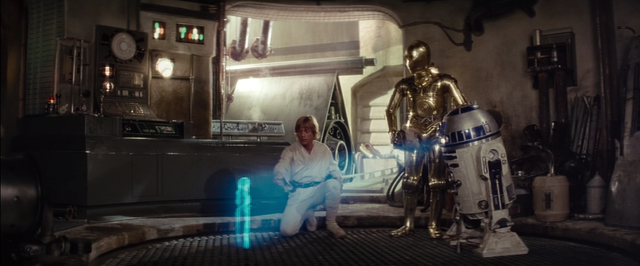 Luke is messing with R2, and Princess Leia's Message starts playing.