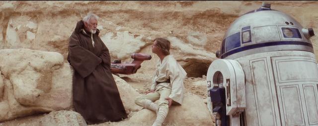 Luke, C-3P0, and R2 Meet Obi-wan in the desert