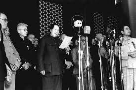 The People's Republic of China is proclaimed, with Mao (president).