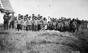 Residential Schools were officially operating. They were created by Christian Churches and the Canadian government.
