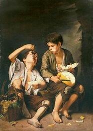 Dos niños comiendo melón y uvas
