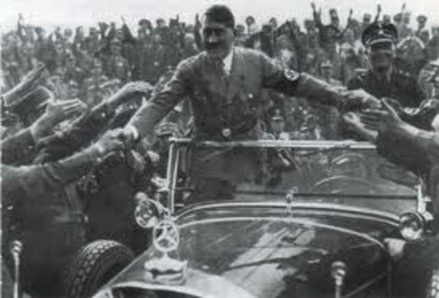 Hitler is greeted by the austrian Nazis