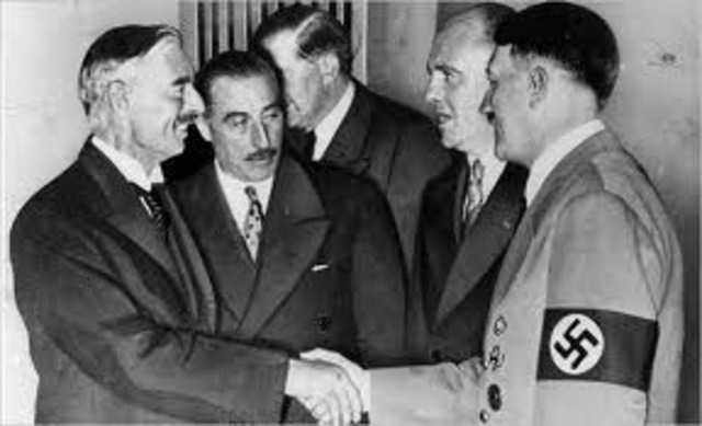 Chamberlain makes an agreement with Hitler to anex the Sudetenland