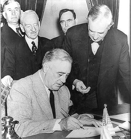 President Roosevelt signs Lend-Lease Act